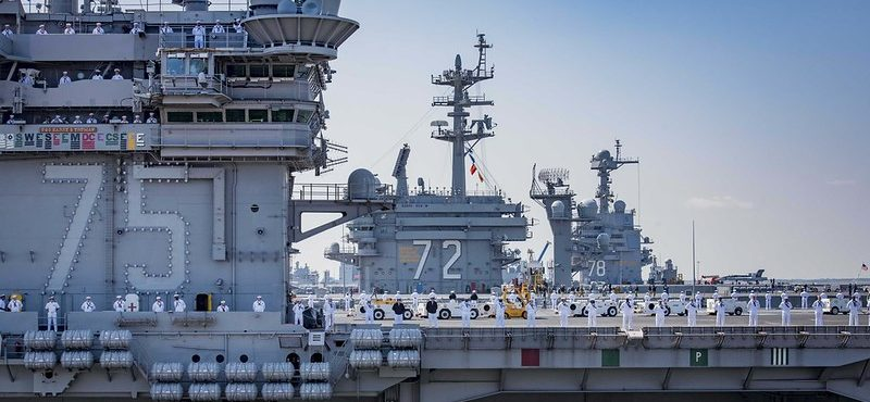 Sailors aboard the aircraft carrier USS Harry S. Truman (CVN 75)